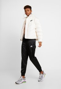 Nike Sportswear - SYN FILL - Winter jacket - pale ivory - 1