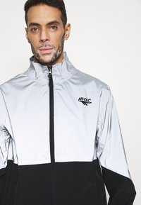 Hi-Tec - MELVIN COLOURBLOCK REFLECTIVE TRACK JACKET - Training jacket - black - 4