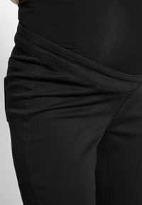 Missguided Maternity - OVER BUMP VICE SUPERSTRETCHY - Jeans Skinny Fit - black - 4