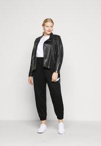 Nike Sportswear - Pantalones deportivos - black/white - 1