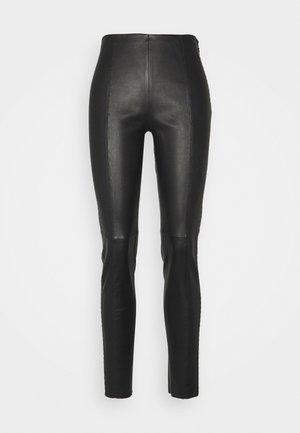 LUXURY ROCKSTAR PANTS - Leather trousers - black