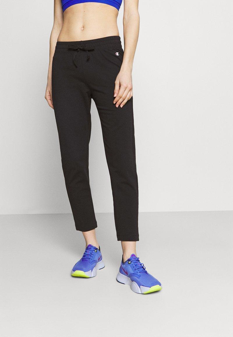 Champion - CUFFED PANTS - Tracksuit bottoms - black