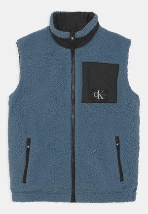 REVERSIBLE - Waistcoat - black