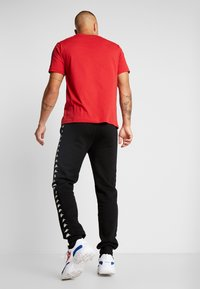 Kappa - VENTUN PANTS - Spodnie treningowe - black - 2