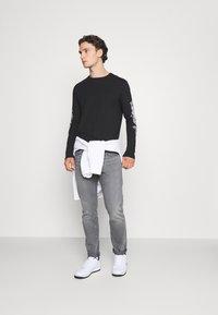 YOURTURN - UNISEX - Long sleeved top - black - 1