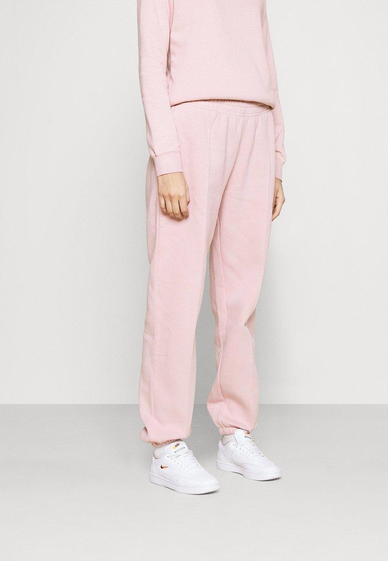 Nike Sportswear - Tracksuit bottoms - champagne