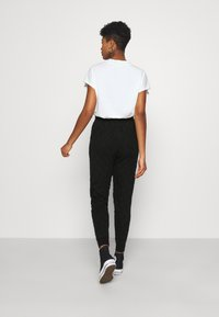Topshop - QUILTED - Tracksuit bottoms - black - 2