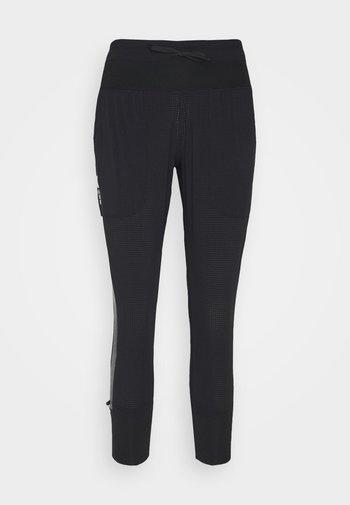 RUN ANYWHERE PANT - Verryttelyhousut - black