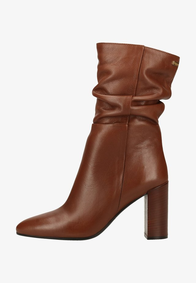 High heeled boots - light brown