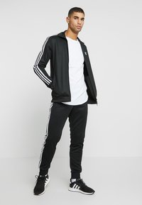 adidas Originals - BECKENBAUER UNISEX - Veste de survêtement - black - 1