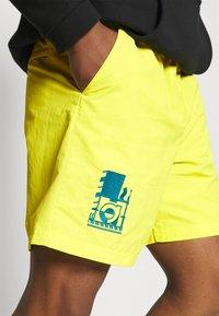 adidas Originals - WOVEN UNISEX - Shorts - acid yellow - 3