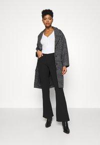JDY - JDYCATIA FLARE - Trousers - black - 1