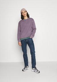 Edwin - TAPERED - Straight leg jeans - blue denim - 1
