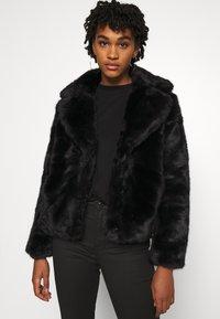 Vero Moda - VMCELINA JACKET - Winter jacket - black - 0