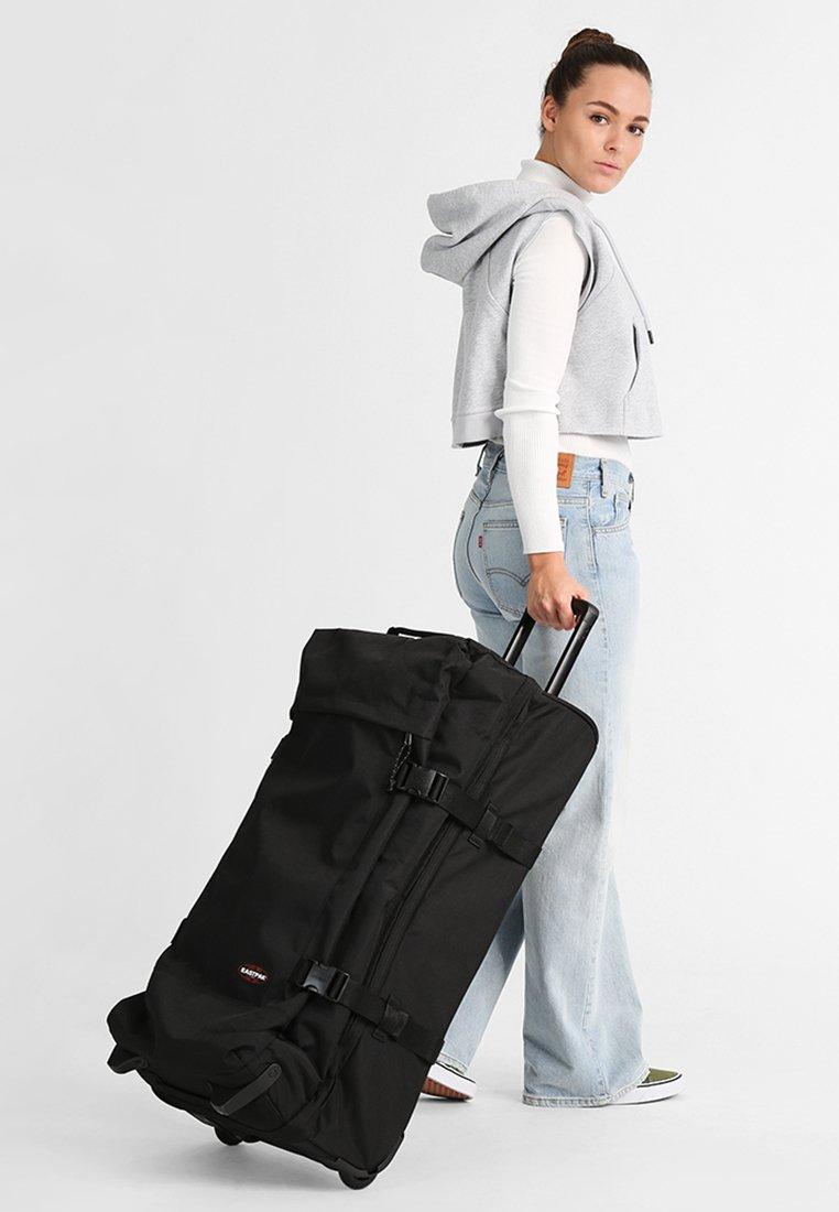Eastpak - Wheeled suitcase - black