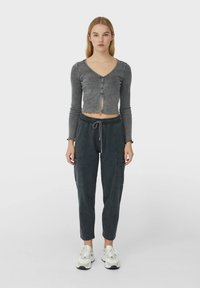 Stradivarius - IM ACID-WASH - Tracksuit bottoms - dark grey - 1