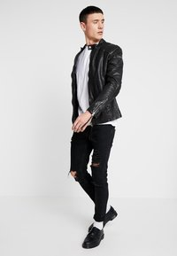 Tigha - NERO - Leather jacket - black - 1