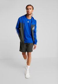 adidas Performance - OWN THE RUN - Träningsshorts - legear/black - 1