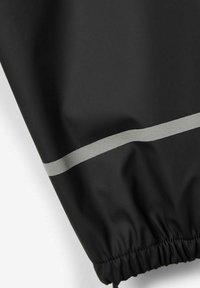 Name it - NKNDRY RAIN SET UNISEX - Rain trousers - black - 5