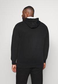 Calvin Klein - LOGO STRIPE HOODIE - Hoodie - black - 2