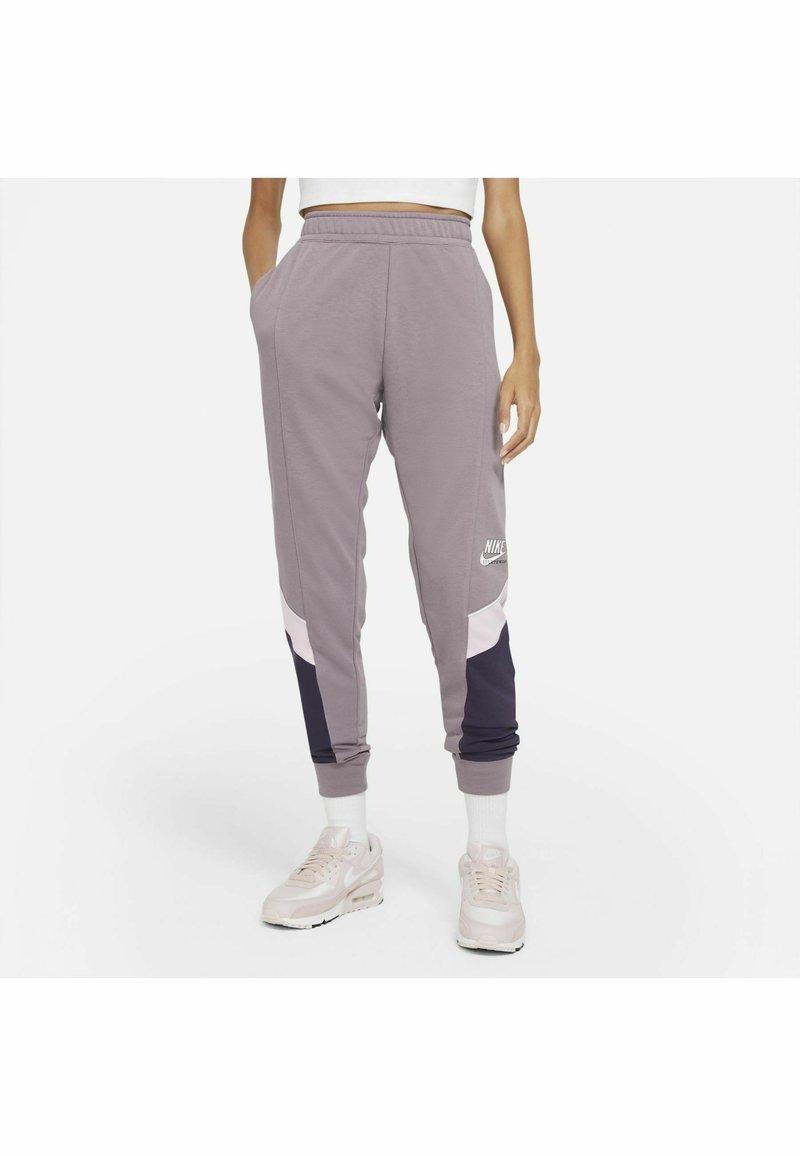 Nike Sportswear - Tracksuit bottoms - purple smoke/dark raisin/pink foam/(white)