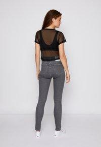Calvin Klein Jeans - BABY TEE - Print T-shirt - black - 2
