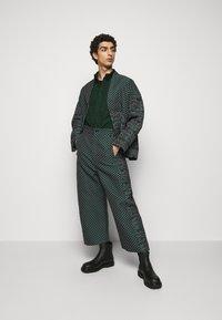 Henrik Vibskov - KEY PANTSMIX DRAIN MIXER - Trousers - dark green - 1