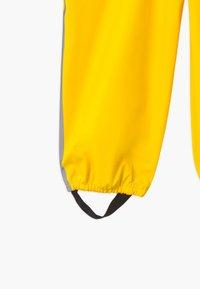Reima - LAMMIKKO - Rain trousers - yellow - 3
