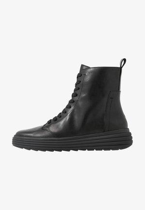 PHAOLAE - Platform ankle boots - black