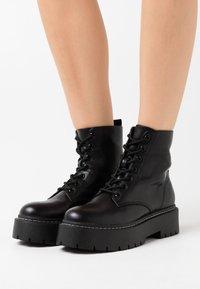 Gioseppo - YELABUGA - Kotníkové boty na platformě - black - 0
