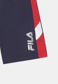 Fila - MIO - Tracksuit bottoms - black iris/true red/bright white - 2