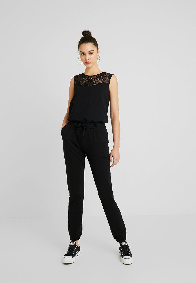Urban Classics - LADIES BLOCK - Jumpsuit - black