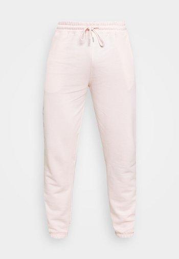 ON THE RUN UNISEX - Pantalon de survêtement - pink