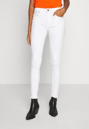 HIGH SKINNY RIPPED ANKLE - Jeans Skinny Fit - white