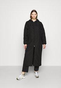 Weekday - MAY LONG JACKET - Winter coat - black - 0