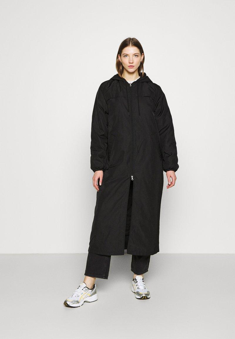 Weekday - MAY LONG JACKET - Winter coat - black