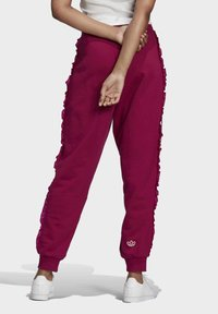 adidas Originals - BELLISTA SPORTS INSPIRED JOGGER PANTS - Tracksuit bottoms - power berry - 1