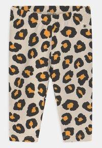 Lindex - LEO ANIMAL 2 PACK UNISEX - Leggings - Trousers - light beige - 1