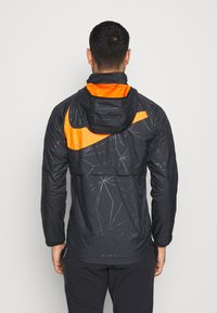 Nike Performance - NIEDERLANDE KNVB  - Veste de survêtement - black/safety orange - 3