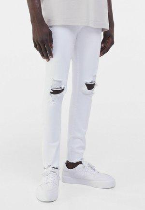 MIT RISSEN  - Jeans Skinny Fit - white