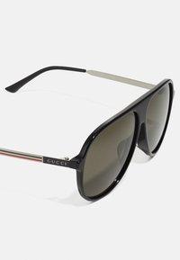 Gucci - Occhiali da sole - black - 5