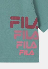 Fila - POLLY CROPPED - Camiseta estampada - cameo blue - 2