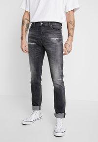 Diesel - TEPPHAR-X - Slim fit jeans - black denim - 0