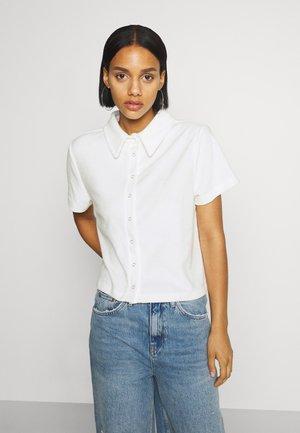 ANYWHERE - Button-down blouse - white