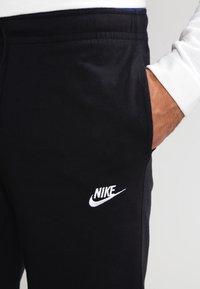 Nike Sportswear - CLUB - Tracksuit bottoms - schwarz/weiß - 3