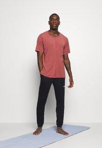 Nike Performance - DRY YOGA - Camiseta básica - claystone red/black - 1