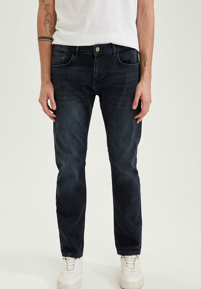 Relaxed fit jeans - indigo