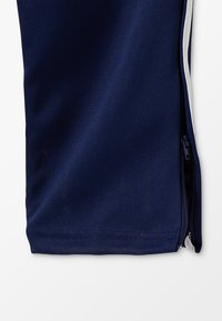 adidas Performance - TIRO AEROREADY CLIMACOOL FOOTBALL PANTS - Pantalones deportivos - dark blue/white - 4