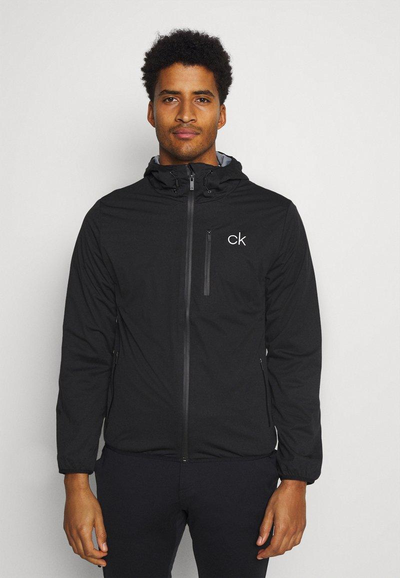 Calvin Klein Golf - ULTRON HOODED JACKET - Waterproof jacket - black