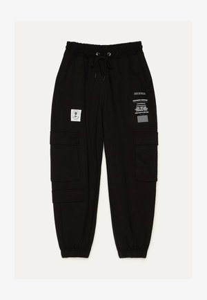 IM CARGOSTIL AUS PLÜSCHGEWEBE  - Teplákové kalhoty - black
